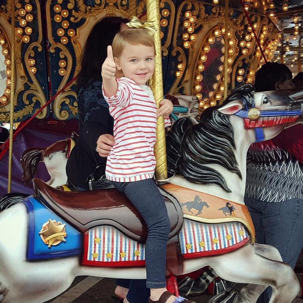 Child on the carousel.