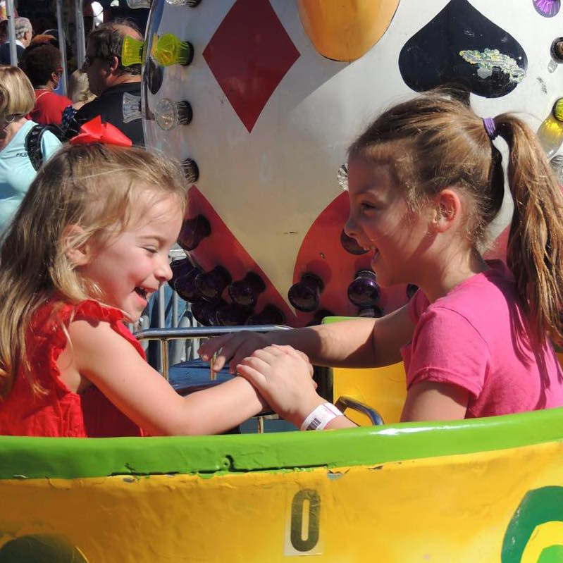 Children on the teacup ride.